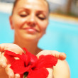 Royalty-Free Stock Photo: Beautiful female holding red flower