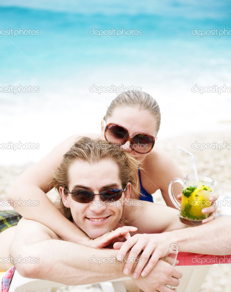 Happy young couple smiling on the beach  Stock Photo #5531972
