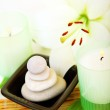 Spa candle and stones — Stock Photo