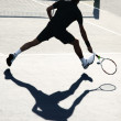 Tennis player in action — ストック写真