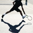 Tennis player in action — Stockfoto