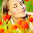 Beautiful female laying on the flower filed — Stock Photo #5720379
