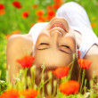 Beautiful female laying on the flower filed — Stock Photo #5720396