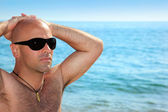 Good looking man on the beach — Stock Photo