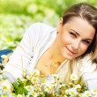 Beautiful female laying on the flower filed — Stock Photo #5838633