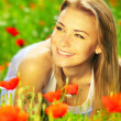 Beautiful female enjoying on the flower field — Stock Photo