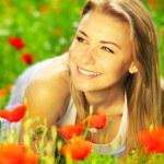 Beautiful female enjoying on the flower field — Stock Photo #5838665