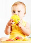 Little baby eating apple — Stock Photo