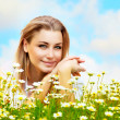 Beautiful female laying on the flower field — Stock Photo #5942182
