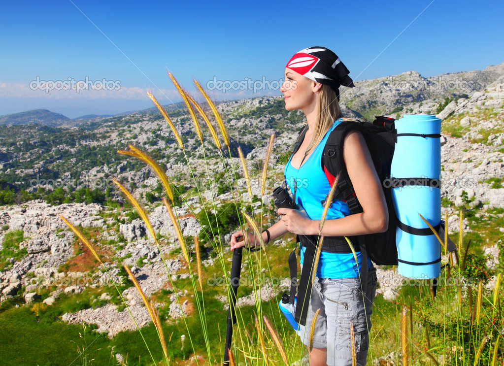 Traveling girl with backpack hiking in the mountains, eco tourism, freedom concept — Stock Photo #5942408