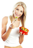 Pretty girl eating fruits — Stock Photo