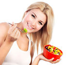 Pretty girl eating fruit salad — Stock Photo