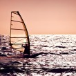 Windsurfer silhouette over sea sunset — Stock Photo #6232265
