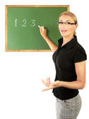Young teacher writing numbers — Stock Photo