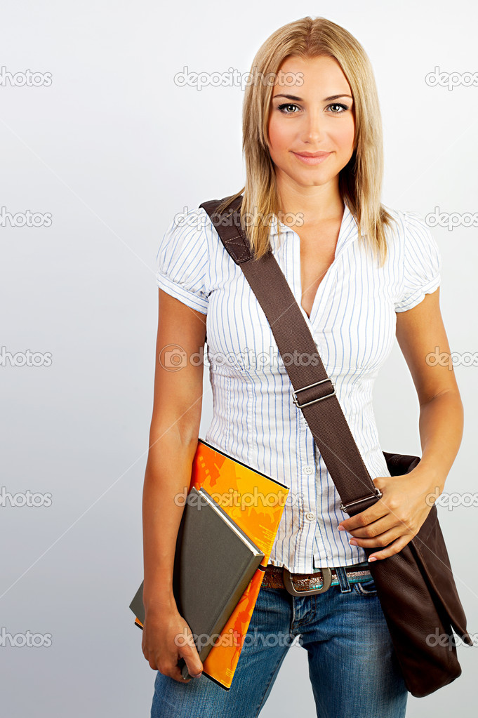 Happy young student girl holding books, study, education, knowledge, goal concept — Photo #6232459