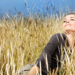 Woman enjoying on the wheat field — Stock Photo #6298931