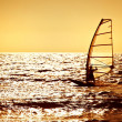 Windsurfer silhouette over sea sunset — Stock Photo