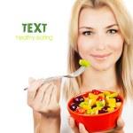 Pretty girl eating fruit salad — Stock Photo