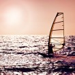 Windsurfer silhouette over sea sunset — Stock Photo #6377328