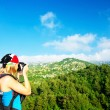 Tourist girl taking pictures - Stock Photo