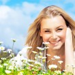 Stock Photo: Happy girl enjoying daisy flower field