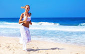 Healthy woman running on the beach — Stock Photo