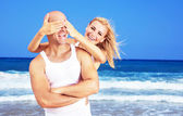 Happy couple having fun on the beach — Stock Photo