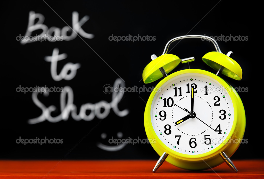 Back to school conceptual image with alarm clock & chalkboard in the classroom — Stock fotografie #6446099