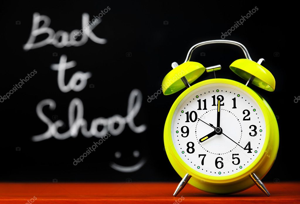 Back to school conceptual image with alarm clock & chalkboard in the classroom — Stok fotoğraf #6446099