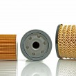 Fuel filter and two oil filters — Stock Photo