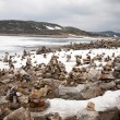 Stock Photo: Snow, ice and rock piles are arranged