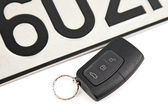 Remote controlled car key and registration plate — Stock Photo