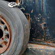 Stock Photo: Rusty wheel on side of old car