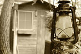 Old lamp in the door of a wooden hut — Stok fotoğraf