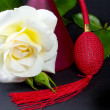 Stock Photo: A white rose and red spray
