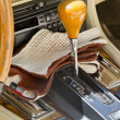Antique car interior with gloves — Stock Photo