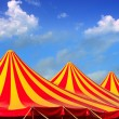 Circus tent red orange and yellow stripped pattern — Stock Photo #5392954