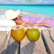 Coconuts woman sun tanning topical beach — Stock Photo