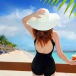 Beach hat rear view woman cocktail tropical beach — Stock Photo #5394535