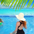 Blue swimming pool caribbean view mother daughter — Stock Photo #5394582