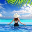 Caribbean sea view from blue pool rear woman — Stock Photo