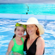 Mother and daughter hug in pool tropical beach — Stock Photo #5394753