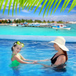 Daughter and mother in swimming pool tropical — Stock Photo #5394835