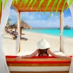 Gazebo tropical beach woman rear view looking sea — Stock Photo #5394908