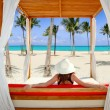 Gazebo tropical beach woman rear view looking sea — Stock Photo
