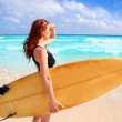 Side view surfer woman tropical sea looking waves — Stock Photo
