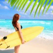 Stock Photo: Side view surfer woman tropical sea looking waves