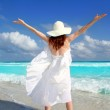 Beach rear woman wind shaking white dress — Stock Photo #5395159