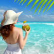 Coconut fresh cocktail profile beach woman drinking - Stock Photo