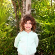 Little tourist girl posing in Mayan Riviera Jungle - Stock Photo